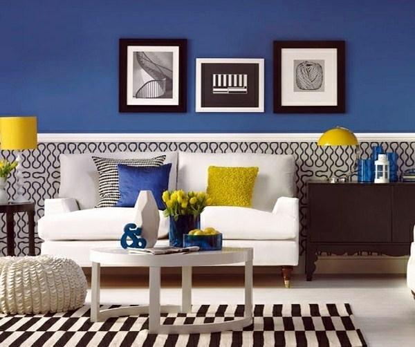 Во избежание однообразности интерьера, комбинируйте основной цвет обоев с другими оттенками, а также используйте картины, фотографии и другие предметы декора стен