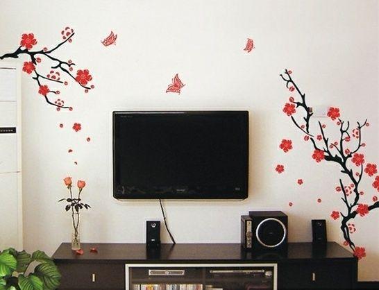 Ветка сакуры будет прекрасно смотреться не только в гостиной, но и в прихожей